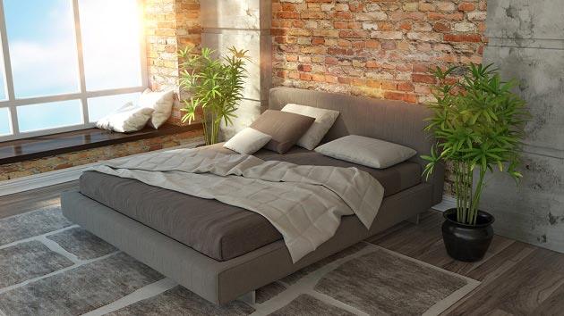 Кровать для подростка в комнате с кирпичной стеной